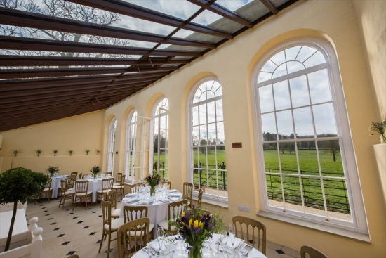 The bright and inviting Orangery, set up for a luncheon.