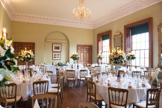 The Ballroom set for for an evening reception, with the head table framed by the alcove.