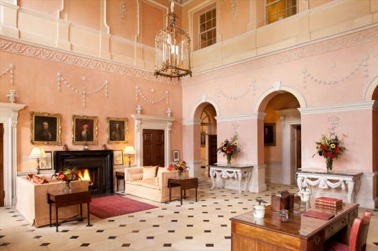 The Great Hall remains as inviting as it was in the 20th century, when this decorative scheme was first used.