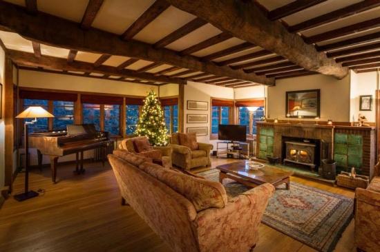 Lounge with wood burner and sea views
