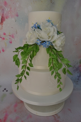 Romantic sugar flowers and piping.