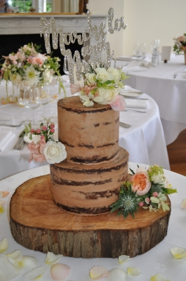 Two tier semi naked cake with a twist!
