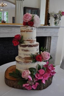 Modern semi naked cake with fresh flowers