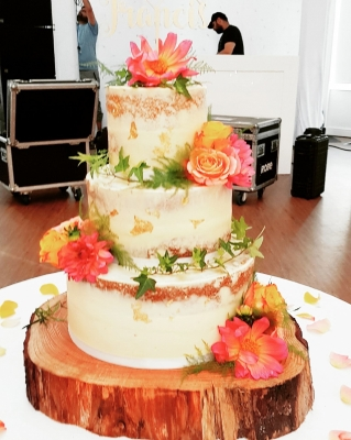 Semi naked wedding cake with gold leaf