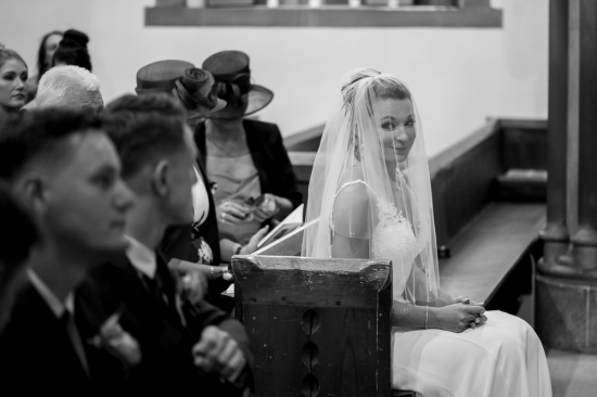 Bride's early glance
