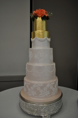 Sugar flowers, gold leaf and lustred designs with stencilled detailing